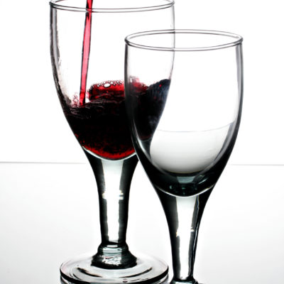 Pouring_red_wine_into_a_glass